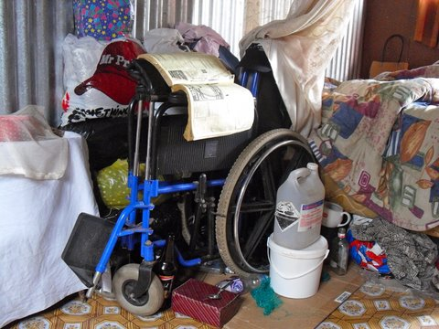 A gogo's wheelchair cramped with her other belongings.